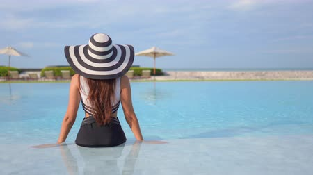 aliciamento : Women around swimming pool in resort for relax in vacation