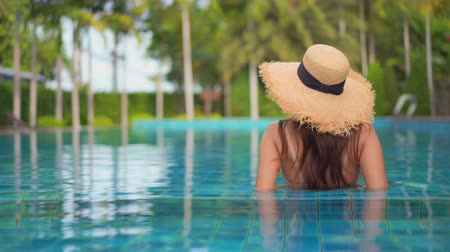 karizmatikus : Women around swimming pool in resort for relax in vacation