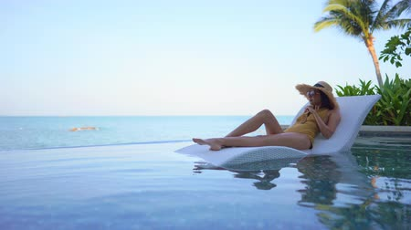 плитка : Women around swimming pool in resort for relax in vacation