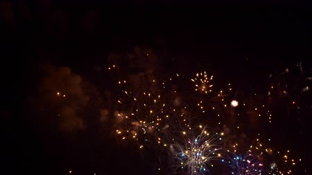 обжиг : Beautiful abstract colourful Fireworks explode display on sky at night a symbol of celebration in New years anniversary for background