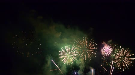 gunpowder : Beautiful abstract colourful Fireworks explode display on sky at night a symbol of celebration in New years anniversary for background