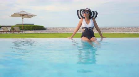 enticing : Women around swimming pool in resort for relax in vacation