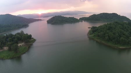 Sunset at lake, topview over lake with the beautiful cloud shot by drone