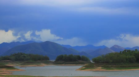 Natural backgrounds stormy sky before raining on mountain and lake Stock Footage