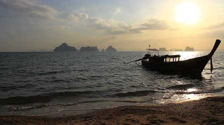peaceful : Longtail boat on sunrise on the coast of Andaman sea in Thailand