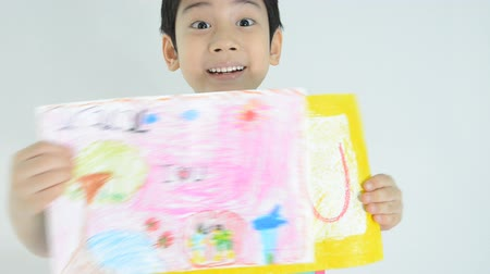 toco : Portrait of a little asian happy boy drawing a sketch, word is I Love You