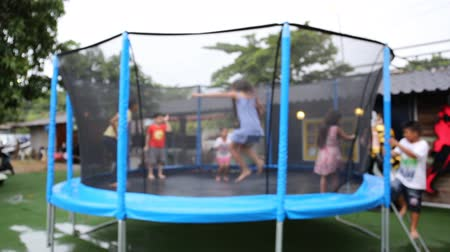 yards : Unidentify Kids jumping on trampoline .