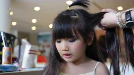 pretty : profession hairstyle artist working with young asian cute child