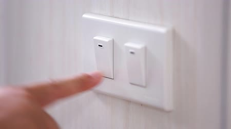 comutar : Close up clips of Mans had turning light on and off, hand groping wall to find light switch, shot in HD video Stock Footage