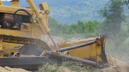 escavador : Unidentified worker control Bulldozer to excavator grader removing the ground Stock Footage