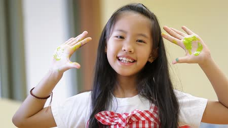little finger : little asian girl with painted palms