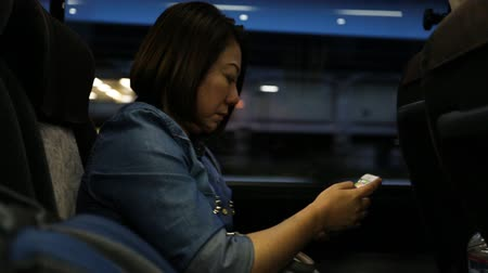 mládeži nepřístupno : Young asian woman using smartphone while riding bus