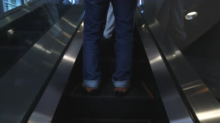 enduring : escalators are shown that constantly run upstairs . Stock Footage