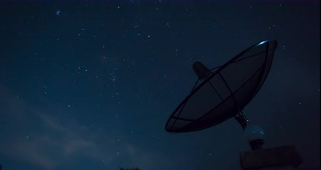 radio wave : Stars Sky Turning Space Astrophotography Time Lapse with Satellite dish communication technology network . Stock Footage