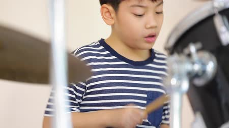 жить : Closeup of asian child drummer practicing for a performance