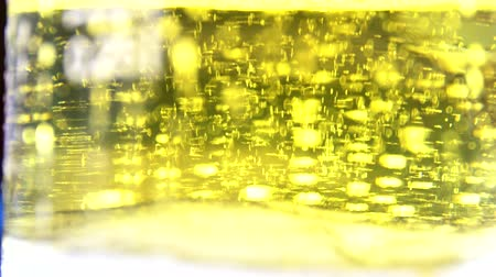 beer house : Glass full of beer slow moving bubbles 4K 3840X2160 UltraHD footage - Bubbles and foam moving fast in glass of beer 4K 2160p UHD video
