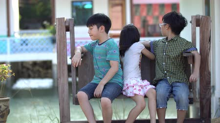 наслаждаться : 4k, Asian children sitting on swing chair outdoor
