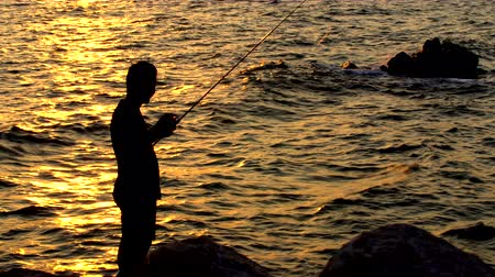 fishermen : fisherman fishing at sunset, silhouette , 4K ,3840 2160 Stock Footage