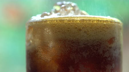 ice cube : Cola with Ice and bubbles in glass, Stock Footage