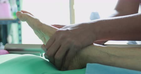 tahy : Side angle of thai foot massage. Physical Therapy at hands to a patient