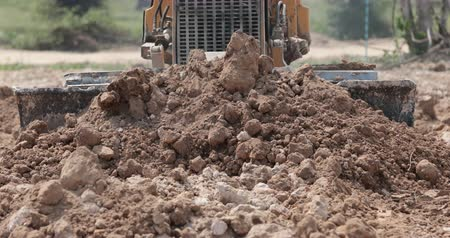 hydraulic : Unidentified worker control Bulldozer to excavator grader removing the ground Stock Footage