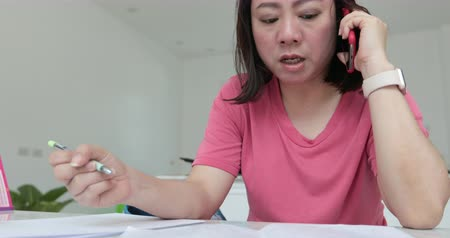 master's degree : Young asian woman reading ,writing and talking concept .How to learning at home for test to masters degree .