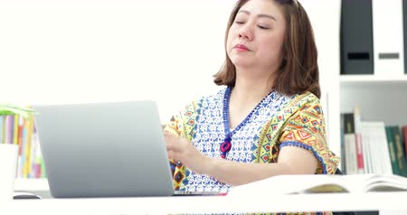 oneself : Young asian businesswoman working with laptop in home. Asian woman stretch oneself after work. Stock Footage