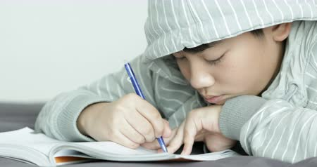 learning to walk : Asian teenage rest and doing your homework