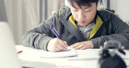 be sad : Angry asian boy doing your homework with feel anxious about, worry  and be tired. Stock Footage