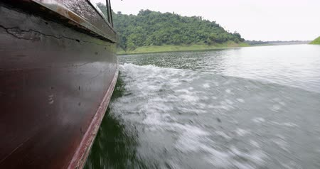 greater : Boat ride at Khun Dan Prakan Chon dam at Nakhon Nayok province in thailand. The park is the largest area of virgin forest in middle Thailand and is a remnant of rain forest which is older. Stock Footage