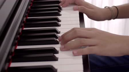 Young asian girl practicing the piano in her room. Stok Video