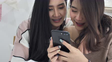 Slow motion of beautiful asian girl using mobile cellphone with smile face.