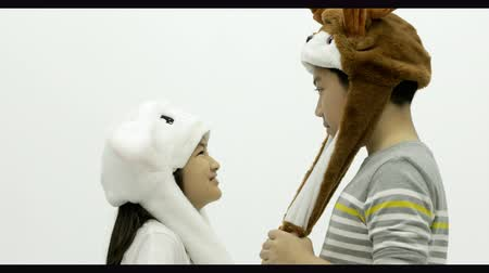 долл : Portrait of asian brother and sister playing fancy hat together with smile face Стоковые видеозаписи