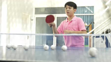 ütő : Asian boy teen practise table tennis from robot table tennis machine, Boy training with shooter machine.