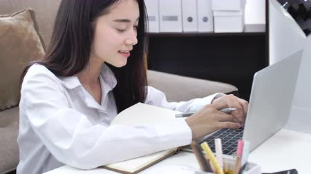 sme : Beautiful teenager business owner work at home, alpha generation life style, prepare parcel box of product for deliver to customer. Young business start up with Online Business or SME Concept.