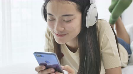 download : Beautiful mature joyful woman listening to music. Young woman using phone for listening to music .