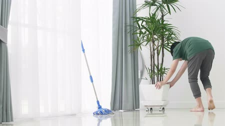 trapo : Asian young boy help family cleaning the house using a mop.