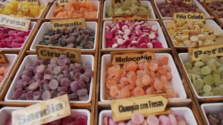 výstava : Sales stand at outdoor market sweet jelly bean, artisans in various colors shapes and fruit flavors