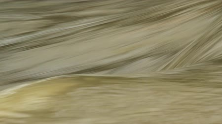 flowing lines : Abstract texture detail descending torrent of muddy water in a river Stock Footage