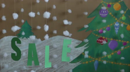 enflasyon : Sale Sign new year. against the background of a painted Christmas tree and snow Stok Video
