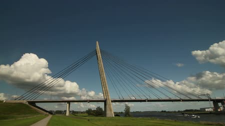 the suspension bridge : Time-lapse clip of a modern suspension bridge with fast moving clouds.