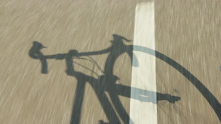 bicycle : Shadow of a racing bike riding on a bicycle path in the country. Stock Footage