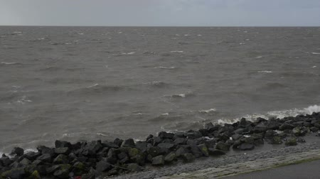 Флеволанд : Waves on the IJsselmeer beating against the dyke of the Noordoostpolder.