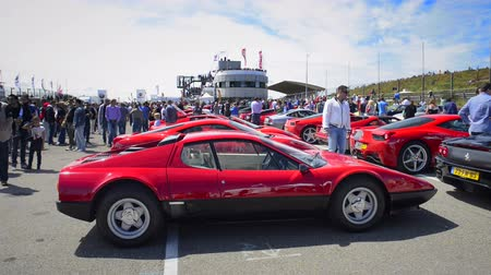 berlinetta : Ferrari 512 Berlinetta Boxer (512BB) classic sports cars parked in the paddock during the Italia a Zandvoort event at the Zandvoort race track. People in the background are looking at the cars.