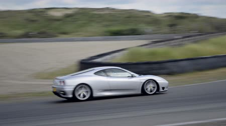 exclusivo : Ferrari 360 Modena sports car driving through a corner  during the Italia a Zandvoort event at the Zandvoort race track.  Stock Footage