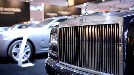 roll : Rolls Royce Ghost front grille with the Spirit of Ecstasy on top at the motor show. The camera is sliding from right to left.