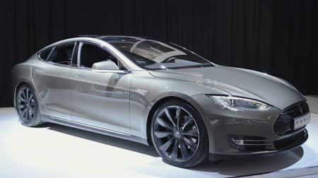 model s : Gray Tesla Model S full-sized electric five-door hatchback on display at the motor show. Stock Footage