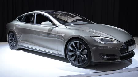 tesla model s : Gray Tesla Model S full-sized electric five-door hatchback on display at the motor show. Stock Footage