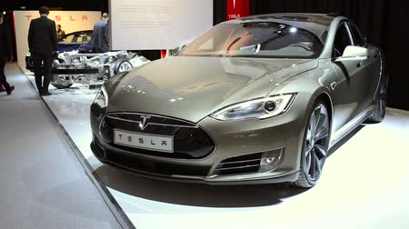 tesla car : Gray Tesla Model S full-sized electric five-door hatchback on display at the motor show. Stock Footage
