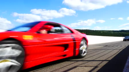 berlinetta : SPA, BELGIUM - SEPTEMBER 27, 2015: Ferrari F355 and 458 Italia and Alfa Romeo GT driving on track during the 2015 Spa Italia event at the Spa Francorchamps racing circuit.